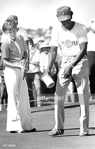 AUG 24 1975 AUG25 1974 Jo Ann Washam and Caddy Ernest Wright who had on 18th Green