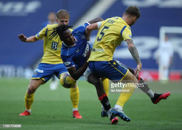 Jo Aribo of Rangers vies with Jason Kerr of St Johnstone during the Scottish Premier League match between Rangers and St Johnstone at Ibrox Stadium...