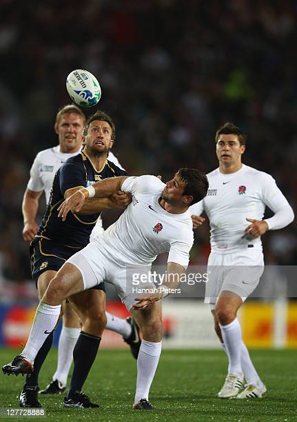 Jo Ben Foden of England fights for the ball with Simon Danielli of Scotland during the IRB 2011 Rugby World Cup Pool B match between England and...