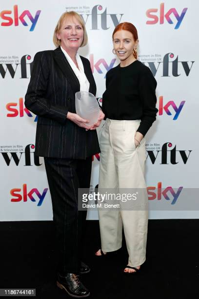 Jo Burn winner of IMDB Project Management Award presented by Stacey Dooley in the winners room at the Women in Film and TV Awards 2019 at Hilton Park...