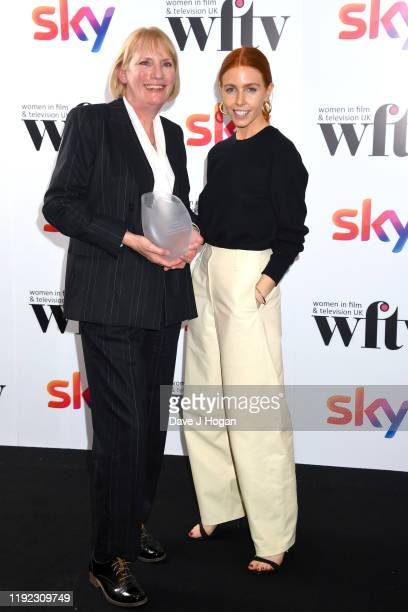 Jo Burn winner of the IMDb Project Management Award and presenter Stacey Dooley during Women in Film TV Awards 2019 at Hilton Park Lane on December...
