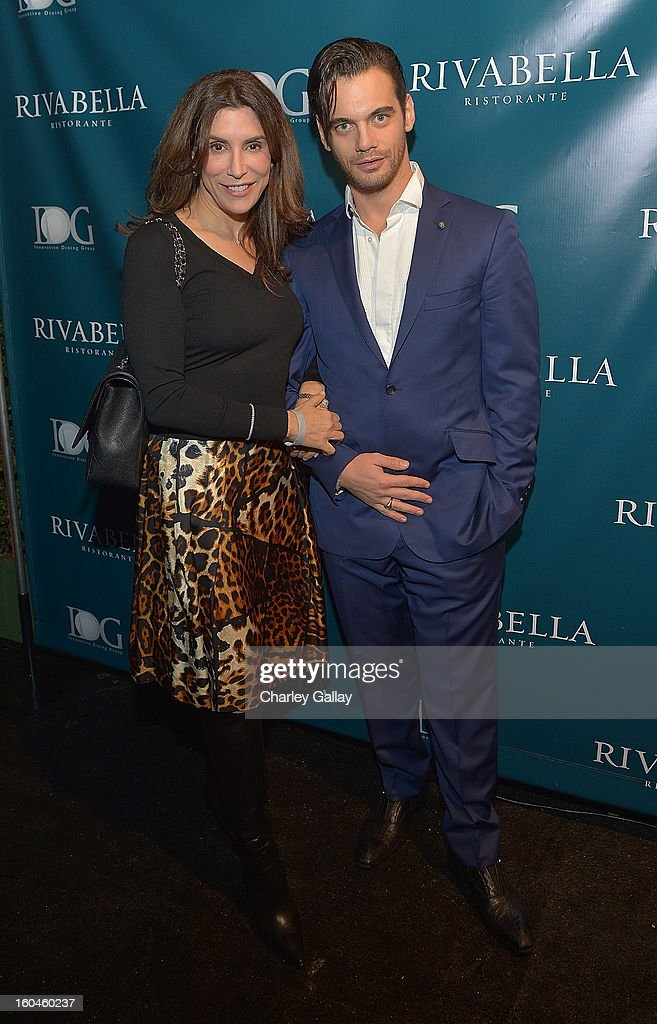 Jo Champa (L) and Theo Alexander attend the Grand Opening of RivaBella Ristorante on January 31, 2013 in West Hollywood, California.