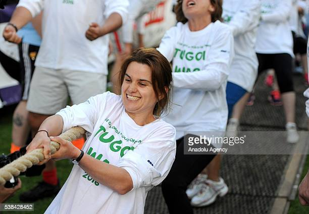 Jo Cox at Lords V House of Commons Tug of War fundraising event for Macmillan Cancer support Westminster College Gardens London on June 6 2016