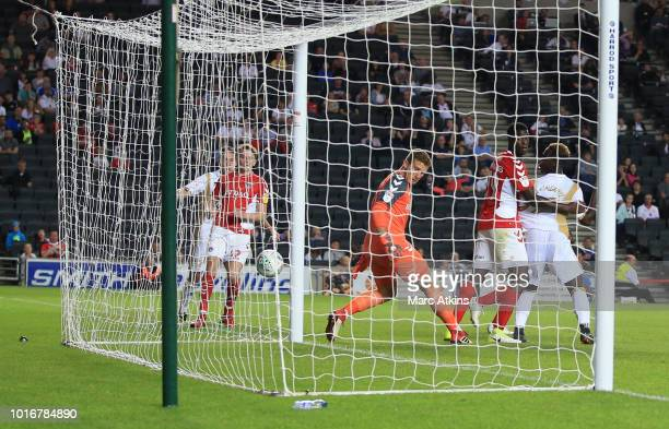 Jo Cummings of Charlton Athletic scores an own goal from a shot by Callum Brittain of MK Dons during the Carabao Cup First Round match between Milton...