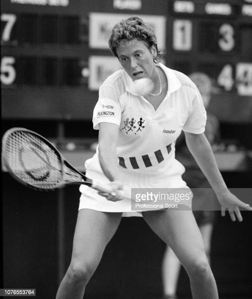 Jo Durie of Great Britain in action against Anke Huber of Germany during the women's singles first round on day two of the 1990 Wimbledon...