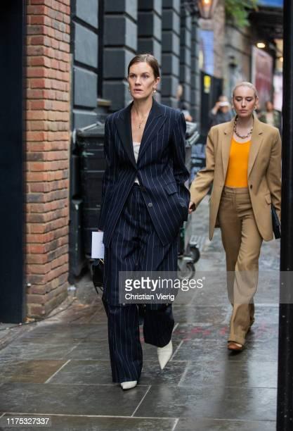 Jo Ellison is seen wearing navy striped suit outside Christopher Kane during London Fashion Week September 2019 on September 16 2019 in London England