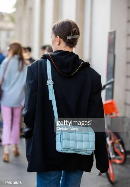 Jo Ellison seen wearing blue turquois Bottega Veneta cross boy bag outside the Tod's show during Milan Fashion Week Spring/Summer 2020 on September...