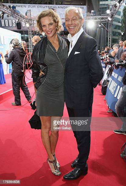 Jo Groebel and Alexandra Rohleder attend the 'White House Down' Germany premiere at CineStar on September 2 2013 in Berlin Germany