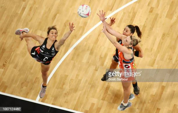 Jo Harten of the Giants and Sharni Layton and Shae Brown of the Magpies compete for the ball during the round 13 Super Rugby match between the...