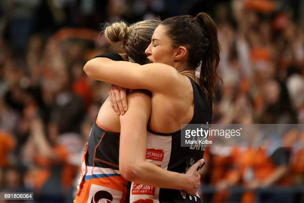 Jo Harten of the Giants and Sharni Layton of the Magpies embrace after during the Super Netball Major Semi Final match between the Giants and the...