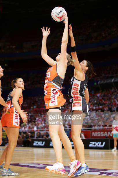 Jo Harten of the Giants is challenged by Sharni Layton of the Magpies during the round nine Super Netball match between the Giants and the Magpies at...