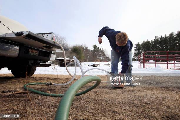 Jo Hartwell owner of Hartwell Farm starts a portable gaspowered pump to move sap from a 325gallon container in the back of her pickup truck into her...