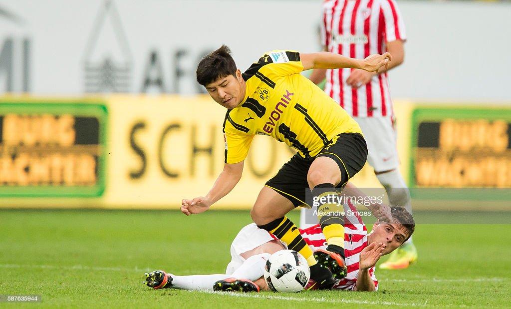 Jo Hoo Park of Borussia Dortmund challenges Javier Eraso of Athletic Bilbao during the friendly match between Athletic Bilbao and Borussia Dortmund at AFG Arena on August 09, 2016 in St. Gallen, Switzerland.