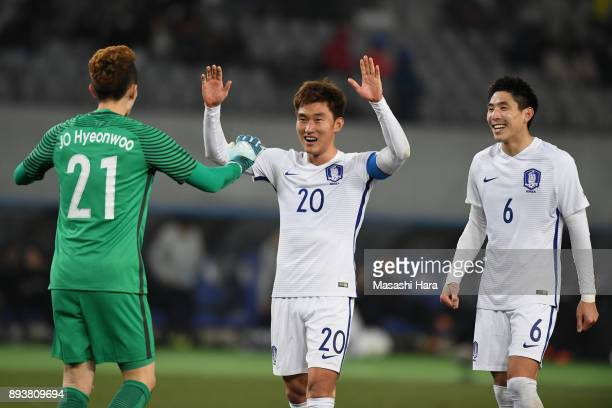 Jo Hyeonwoo Jang Hyunsoo and Yun Youngsun of South Korea celebrate the East Asian Champions following their 41 victory in the EAFF E1 Men's Football...