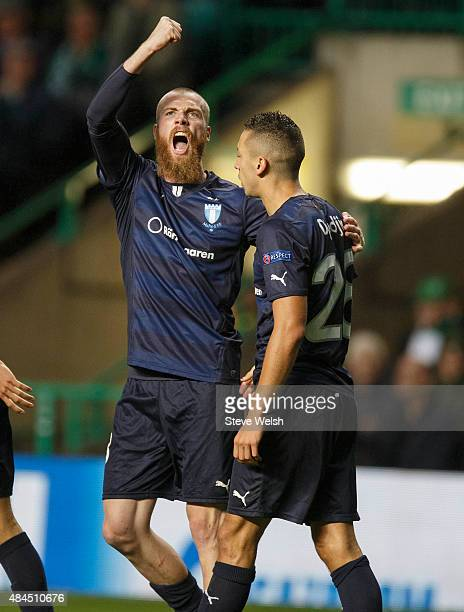 Jo Inge Berget of Malmo FF celebrates scoring with teammate Nikola Djurdic during the UEFA Champions League Qualifying Round playoff first leg match...