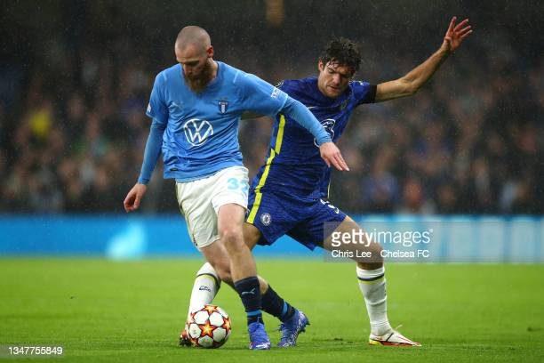 Jo Inge Berget of Malmo FF turns away from Marcos Alonso of Chelsea during the UEFA Champions League group H match between Chelsea FC and Malmo FF at...