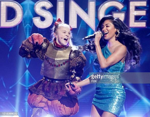 Jo Jo Siwa and Nicole Scherzinger in the Old Friends, New Clues: Group C Championships episode of THE MASKED SINGER airing Wednesday, March 25 on FOX.