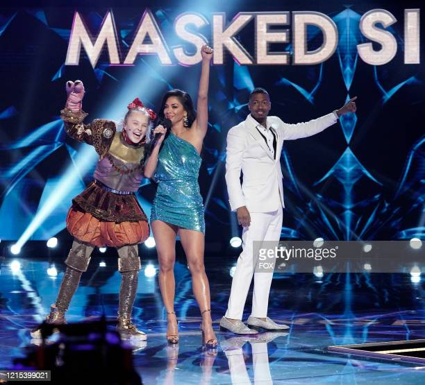 Jo Jo Siwa, Nicole Scherzinger and Nick Cannon in the Old Friends, New Clues: Group C Championships episode of THE MASKED SINGER airing Wednesday,...