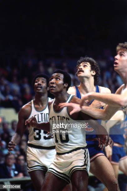 Jo Jo White of the Boston Celtics boxes out Phil Jackson of the New York Knicks circa 1972 at the Boston Garden in Boston Massachusetts NOTE TO USER...