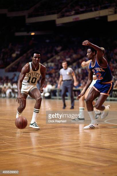 Jo Jo White of the Boston Celtics dribbles the ball against Dick Barnett of the New York Knicks during a game circa 1972 at the Boston Garden in...