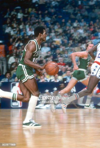 Jo Jo White of the Boston Celtics dribbles the ball against the Washington Bullets during an NBA basketball game circa 1976 at the Capital Centre in...