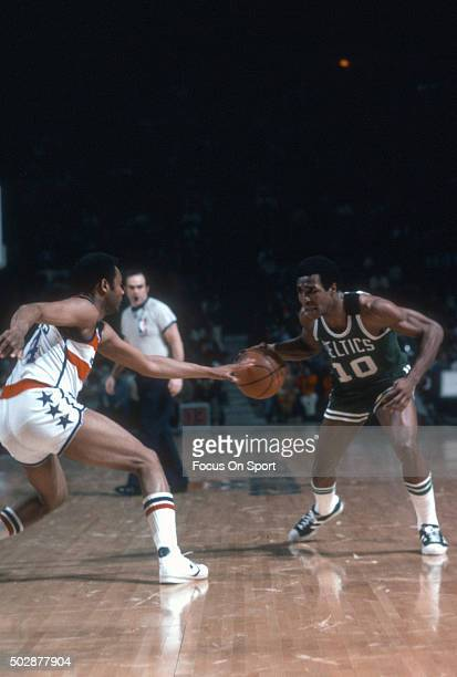 Jo Jo White of the Boston Celtics dribbles the ball against the Washington Bullets during an NBA basketball game circa 1978 at the Capital Centre in...