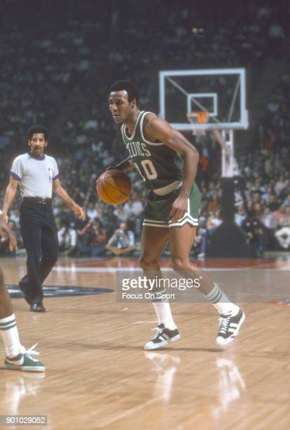 Jo Jo White of the Boston Celtics dribbles the ball against the Washington Bullets during an NBA basketball game circa 1975 at the Capital Centre in...