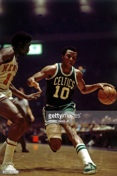 Jo Jo White of the Boston Celtics drives to the basket while guarded by Earl Monroe of the New York Knicks at Madison Square Garden in New York New...