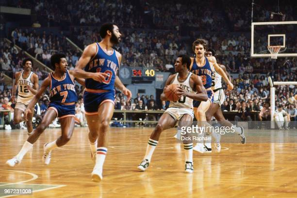Jo Jo White of the Boston Celtics handles the ball against the New York Knicks circa 1974 at the Boston Garden in Boston Massachusetts NOTE TO USER...