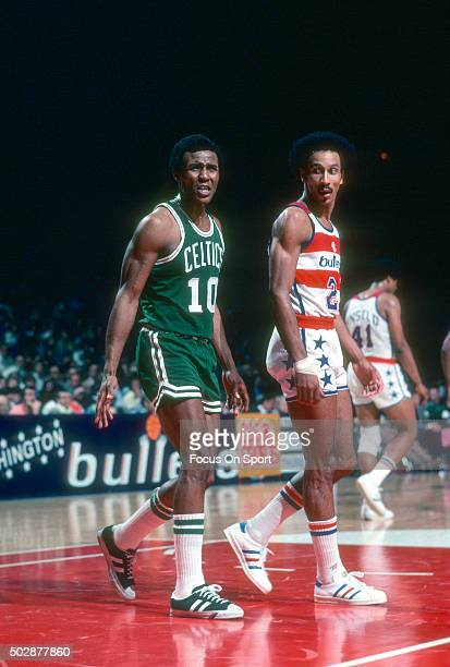 Jo Jo White of the Boston Celtics looks on with Dave Bing of the Washington Bullets during an NBA basketball game circa 1976 at the Capital Centre in...