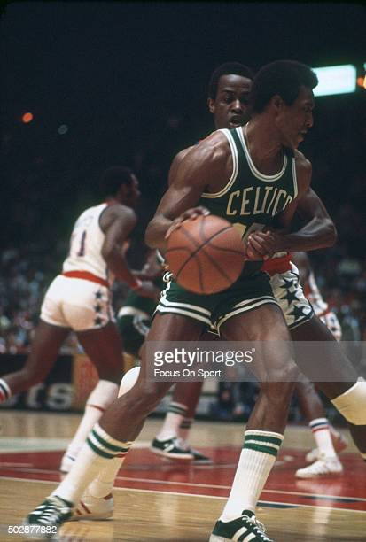 Jo Jo White of the Boston Celtics looks to drive on Jimmy Jones of the Washington Bullets during an NBA basketball game circa 1976 at the Capital...