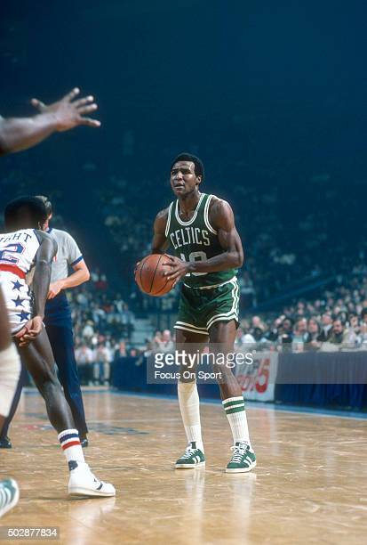 Jo Jo White of the Boston Celtics looks to pass the ball against the Washington Bullets during an NBA basketball game circa 1976 at the Capital...