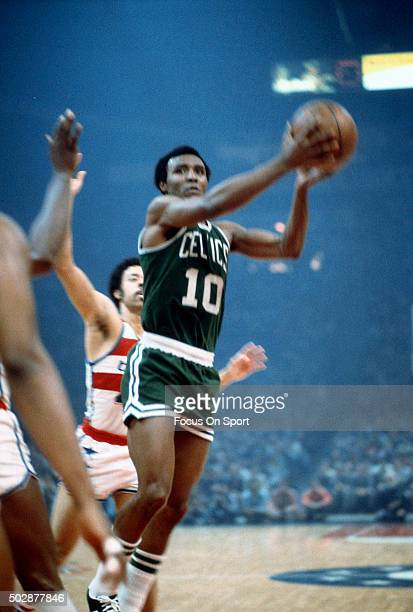Jo Jo White of the Boston Celtics looks to pass the ball against the Washington Bullets during an NBA basketball game circa 1975 at the Capital...
