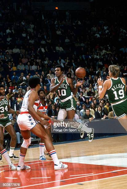 Jo Jo White of the Boston Celtics passes the ball to Don Nelson against the Washington Bullets during an NBA basketball game circa 1976 at the...
