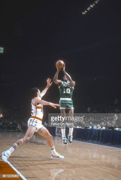 Jo Jo White of the Boston Celtics shoots over Phil Chenier of the Washington Bullets during an NBA basketball game circa 1977 at the Capital Centre...