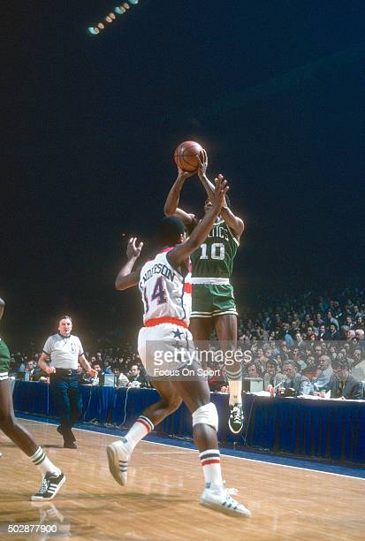 Jo Jo White of the Boston Celtics shoots over Tom Henderson of the Washington Bullets during an NBA basketball game circa 1977 at the Capital Centre...