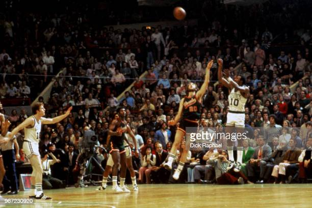 Jo Jo White of the Boston Celtics shoots the ball against the Milwaukee Bucks circa 1974 at the Boston Garden in Boston Massachusetts NOTE TO USER...