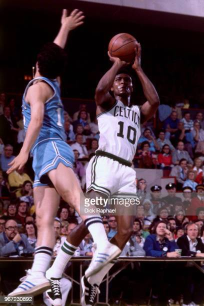 Jo Jo White of the Boston Celtics shoots the ball against the Buffalo Braves circa 1974 at the Boston Garden in Boston Massachusetts NOTE TO USER...