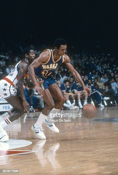 Jo Jo White of the Golden State Warriors dribbles the ball past Larry Write of the Washington Bullets during an NBA basketball game circa 1979 at the...