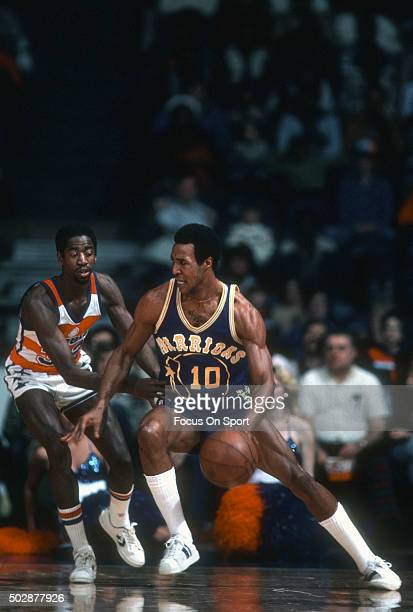 Jo Jo White of the Golden State Warriors drives on Larry Wright of the Washington Bullets during an NBA basketball game circa 1979 at the Capital...