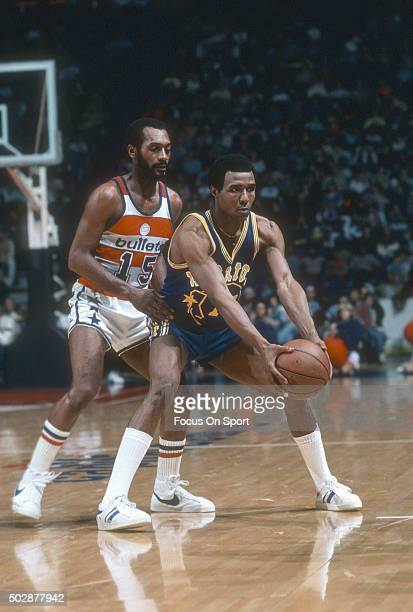 Jo Jo White of the Golden State Warriors looks to pass the ball while guarded by Charles Johnson of the Washington Bullets during an NBA basketball...