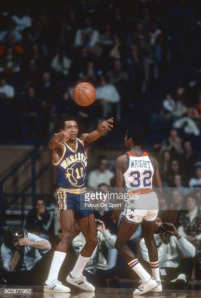 Jo Jo White of the Golden State Warriors passes the ball over the top of Larry Wright of the Washington Bullets during an NBA basketball game circa...
