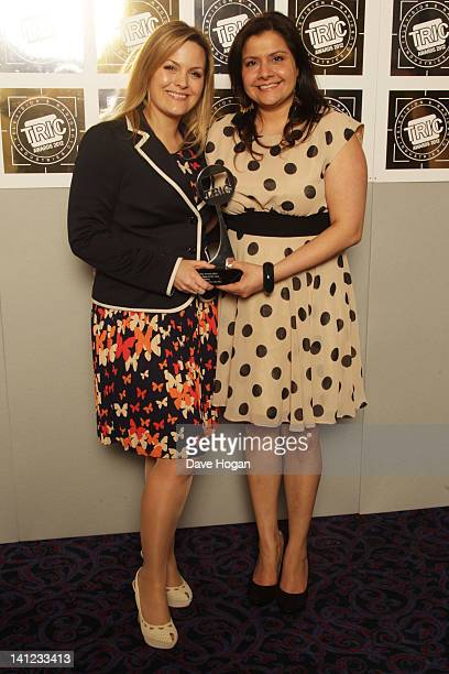 Jo Joyner and Nina Wadia pose in front of the winners boards at the TRIC Television and Radio Industries Club Awards at The Grosvenor House Hotel on...