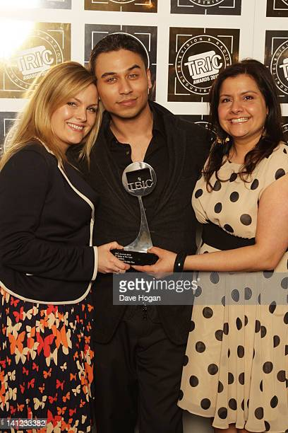 Jo Joyner Ricky Norwood and Nina Wadia of Eastenders pose in front of the winners boards at the TRIC Television and Radio Industries Club Awards at...