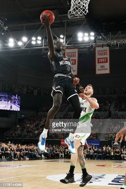 Jo Lual Acuil of United drives to the basket against Mitch Creek of the Phoenix during the round one NBL match between Melbourne United and the South...