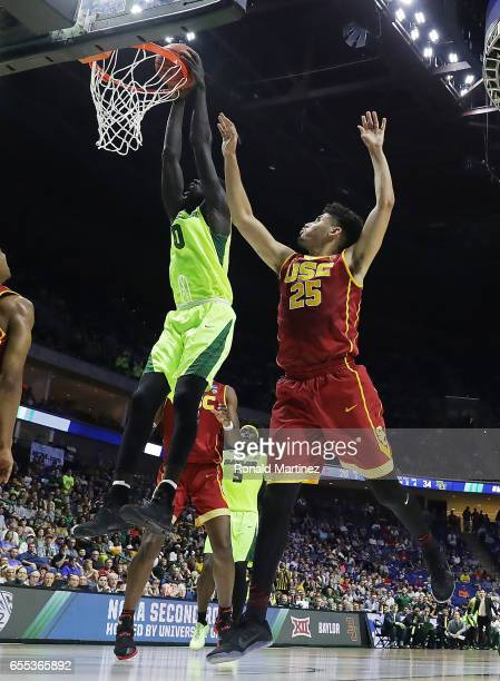 Jo LualAcuil Jr #0 of the Baylor Bears dunks the ball past Bennie Boatwright of the USC Trojans during the second round of the 2017 NCAA Men's...
