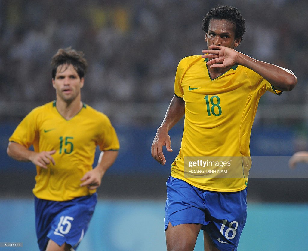 Jo of Brazil (R) celebrates a goal next to his team-mate Diego during the 2008 Beijing Olympic Games men's football bronze medal match Brazil vs Belgium in Shanghai on August 22, 2008. Brazil defeated Belgium 3-0. AFP PHOTO/HOANG DINH Nam