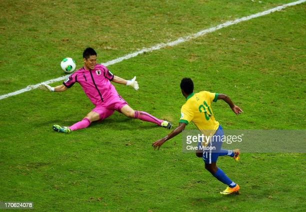 Jo of Brazil scores his team's third goal past Eiji Kawashima of Japan during the FIFA Confederations Cup Brazil 2013 Group A match between Brazil...