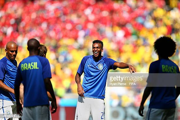 Jo of Brazil shares a joke with teammates during a warm up prior to the 2014 FIFA World Cup Brazil Round of 16 match between Brazil and Chile at...