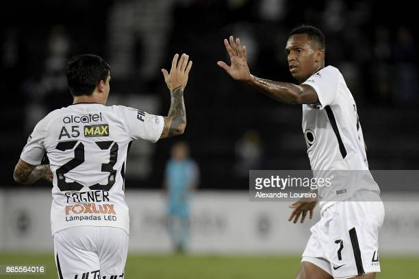 Jo of Corinthians celebrates a scored goal with Fagner during the match between Botafogo and Corinthians as part of Brasileirao Series A 2017 at...